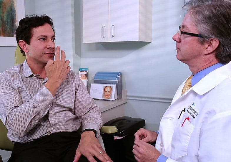 Dr. Gross consulting with a male patient