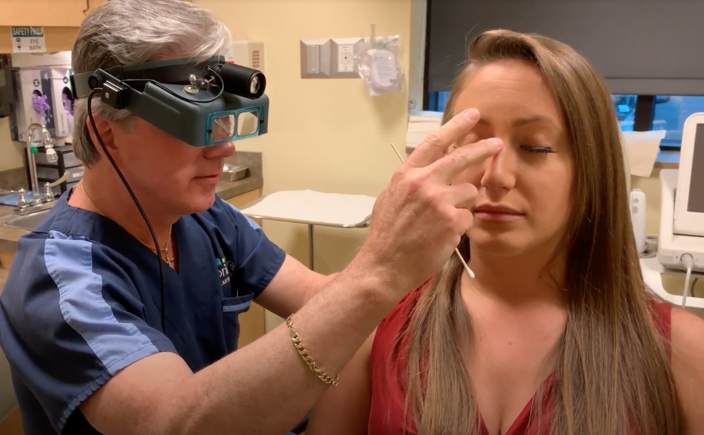 Dr. gross examining the nose of an actual rhinoplasty patient