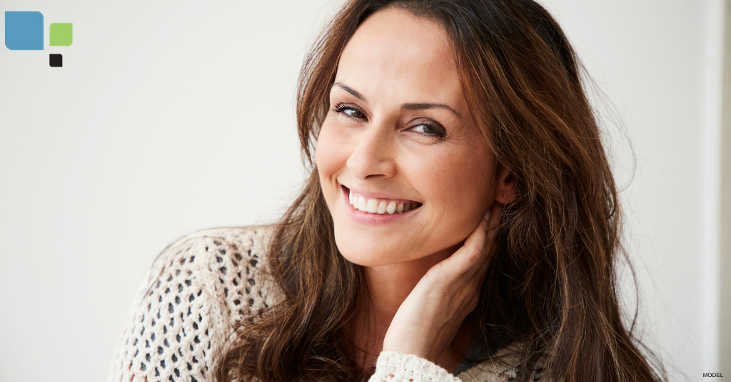 Woman smiling after Fraxel® laser treatments