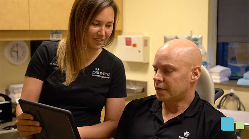 Dr. Gross staff member consulting with actual mole removal patient